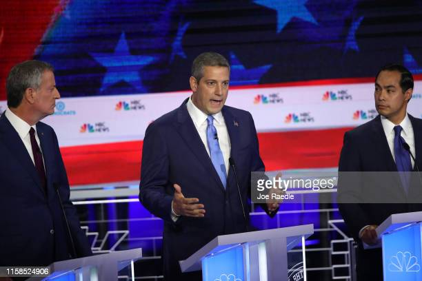 Rep Tim Ryan speaks as New York City Mayor Bill De Blasio and former housing secretary Julian Castro look on during the first night of the Democratic...