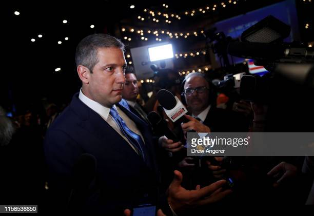 Rep Tim Ryan speaks to the media in the spin room following the first night of the Democratic presidential debate on June 26 2019 in Miami Florida A...