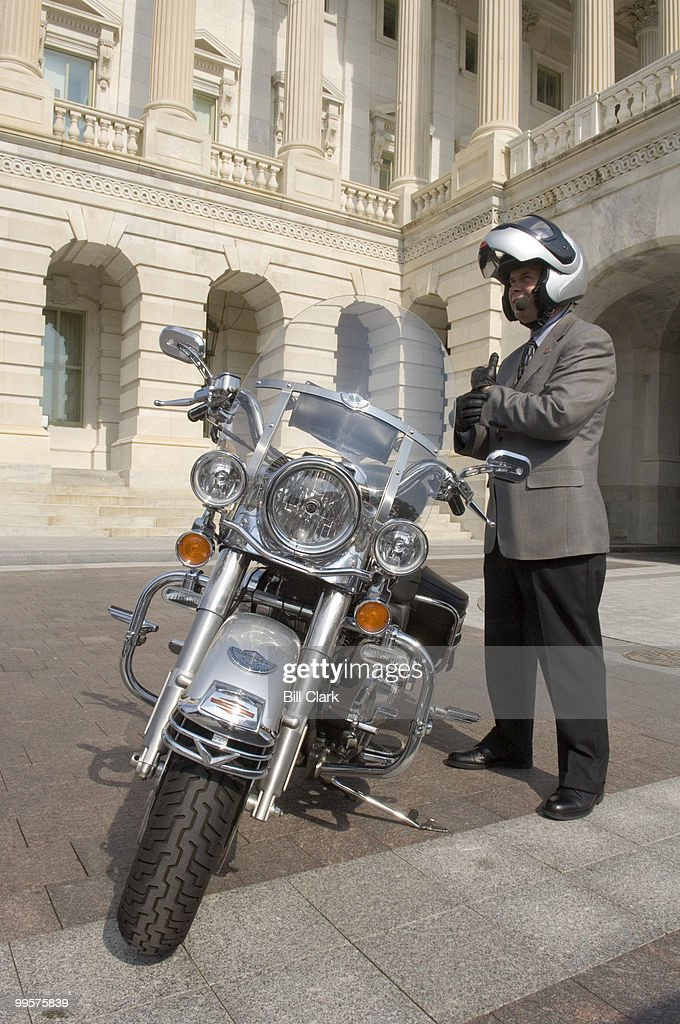 Rep. Tim Walberg, R-Mich., today participated in National Ride to Work Day and rode a Harley Davidson to the east steps of the U.S. Capitol on Wednesday, July 18, 2007.