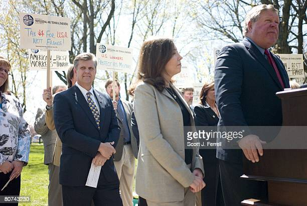 S Rep Todd Tiahrt RKan arms crossed during a rally with other members of Congress and representatives of the International Federation of Professional...