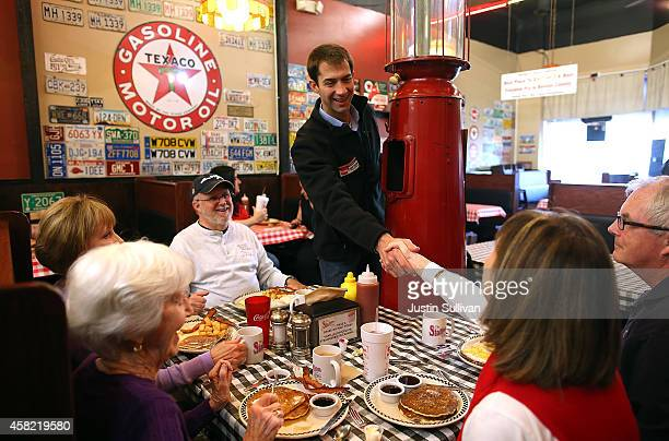 S Rep Tom Cotton and Republican candidate for US Senate in Arkansas greets customers at the Station Cafe on November 1 2014 in Bentonville Arkansas...