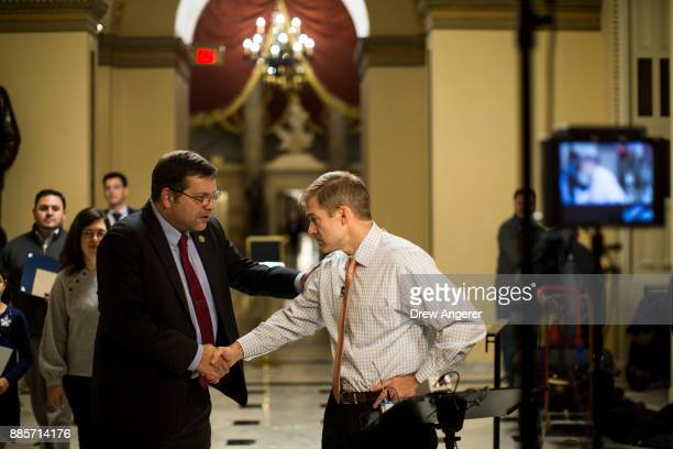 Rep Tom Garrett Jr shakes hands with House Freedom Caucus member Rep Jim Jordan on his way to the House floor on Capitol Hill December 4 2017 in...