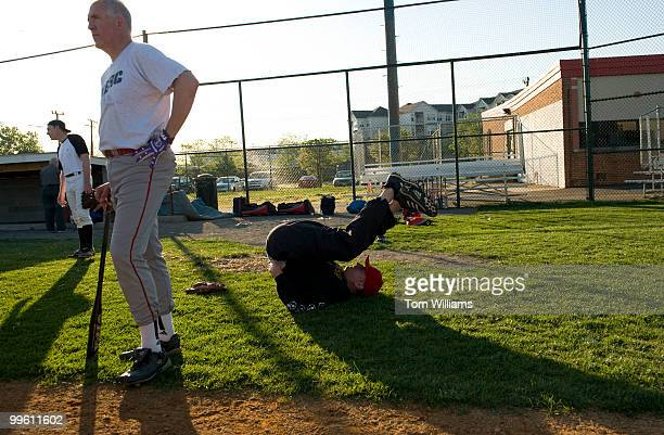 Rep Tom Rooney RFla stretches while Rep John Shimkus RIll oversees play at republican baseball practice at Four Mile Run Park in Arlington April 28...