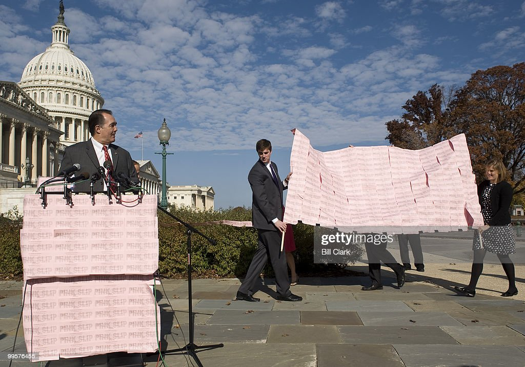 Rep. Trent Franks, R-Ariz., waits for other members and his backdrop to arrive at the House Triangle on Tuesday, Nov. 17, 2009, for a news conference on 'pink slips' for members of Congress who vote for government controlled health care