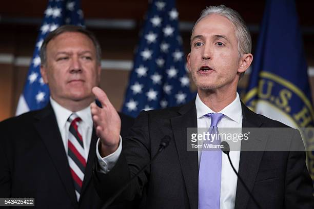 Rep. Trey Gowdy, R-S.C., right, chairman of the Select Committee on Benghazi, conducts a news conference in the Capitol Visitor Center, June 28 to...