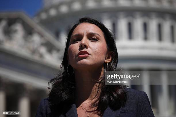 Rep Tulsi Gabbard speaks at a press conference on House Resolution 922 outside the US Capitol July 18 2018 in Washington DC Gabbard and Rep Walter...
