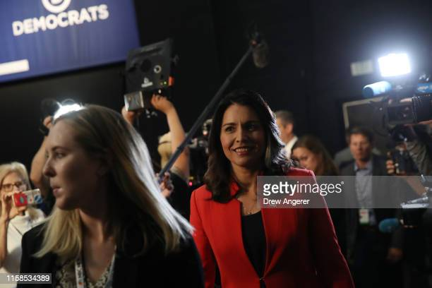 Rep Tulsi Gabbard walks through the spin room after the first night of the Democratic presidential debate on June 26 2019 in Miami Florida A field of...