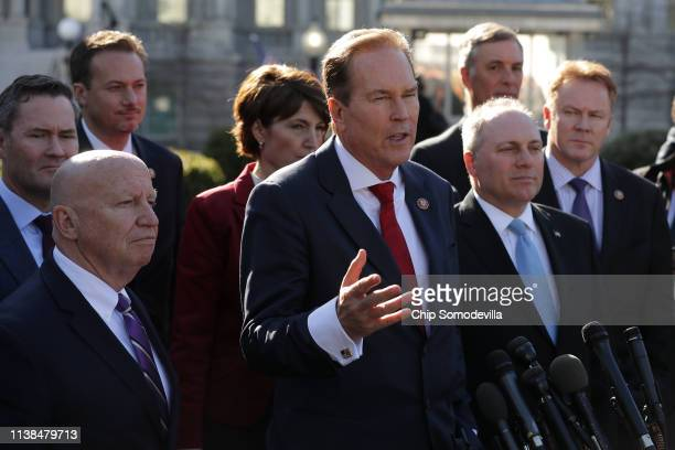 Rep Vern Buchanan is joined by fellow Republican members of the House while talking to reporters outside the White House West Wing March 26 2019 in...