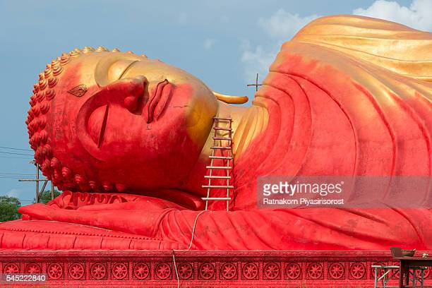 Repainting of Reclining Buddha statue in Lam Poh Temple