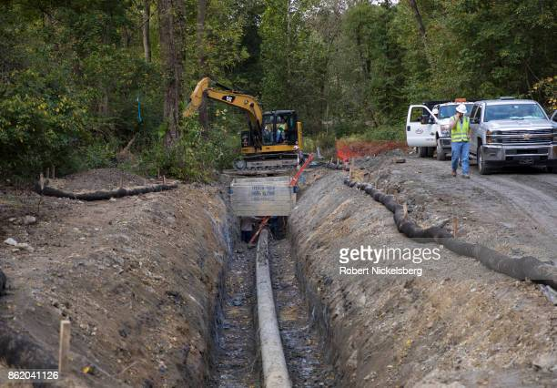 A repair team works on an exposed section of a 1937 aviation fuel pipeline October 6 2017 in Exton Pennsylvania