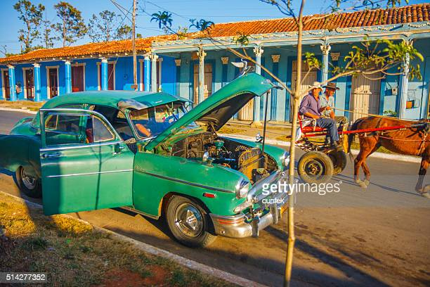Repairing car on the streets of Vinales Cuba