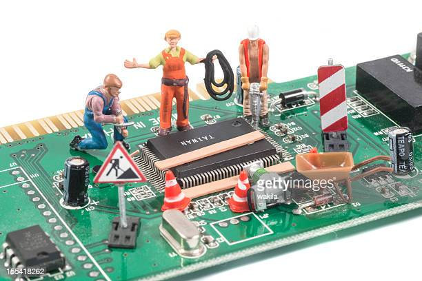 repairing computer equipment with figurines