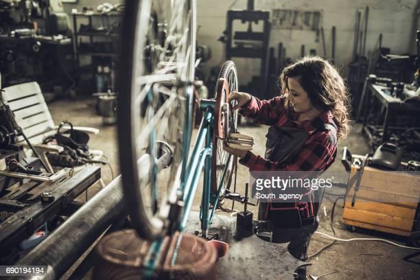 Repairing her bike