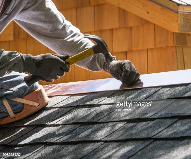 repairing roof. nailing flashing - roof stock pictures, royalty-free photos & images