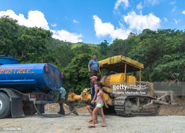Repairing the broken bridges in the area of Jibacoa Truck full of fuel feeds a bulldozer Many bridges and infrastructure were razed by the tropical...