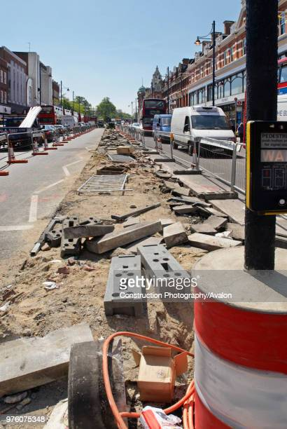 Repairing the central reservation area of Brixton Road South London UK