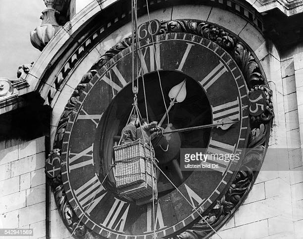 Repairing the hands of the clock of St Paul's Cathedral