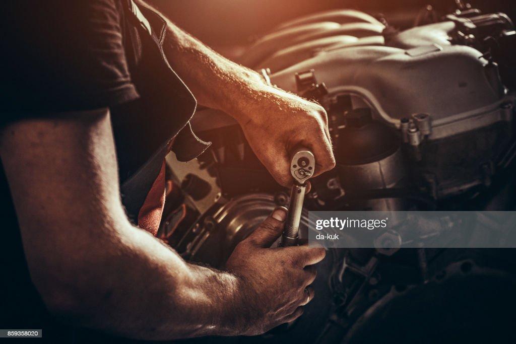Repairing V10 engine in auto repair shop : Stock Photo