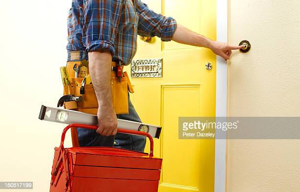 repairman arriving at a front door - craftsperson stock pictures, royalty-free photos & images