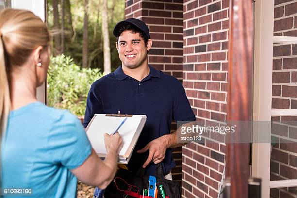 Repairman at customer's front door.