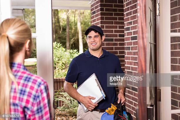 Repairman at customer's front door.