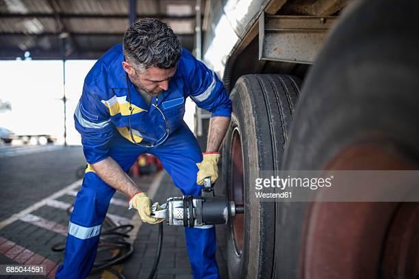 Repairman changing tire
