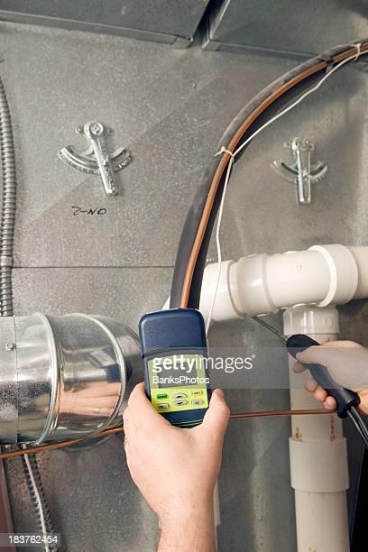 Repairman Checks Carbon Monoxide Level on Furnace Duct