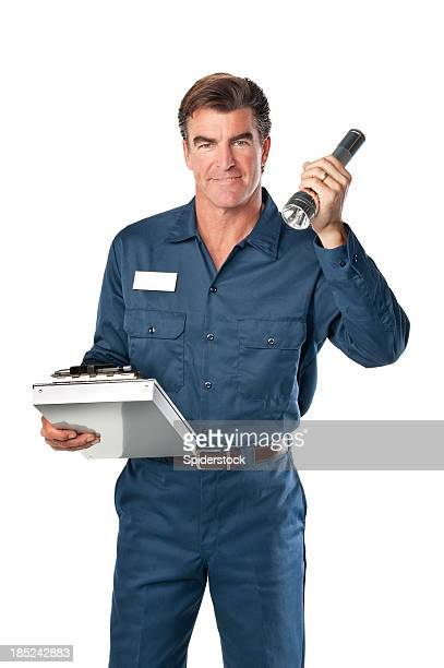 repairman in uniform and flashlight - long sleeved stock pictures, royalty-free photos & images