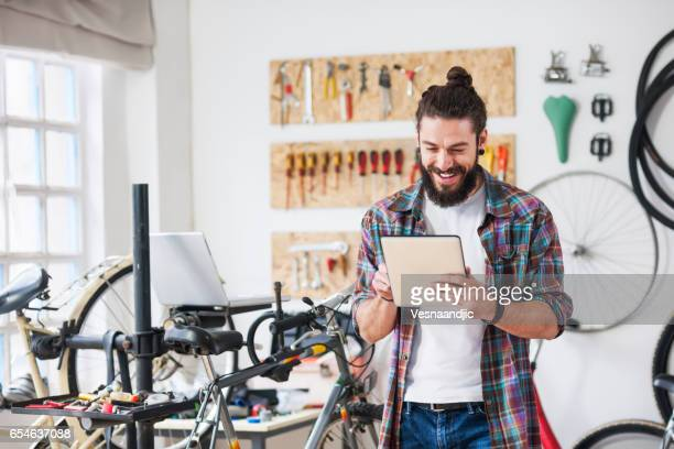 Repairman repairing bicycle in workshop