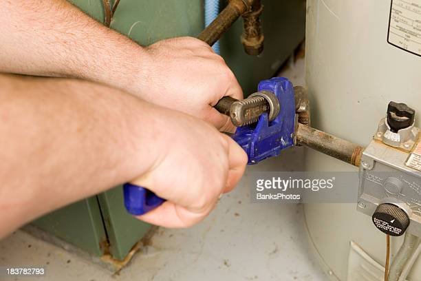 Repairman Tightens Gas Pipe with a Monkey Wrench