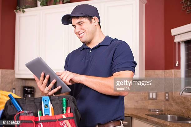 Repairman working inside customer's home.