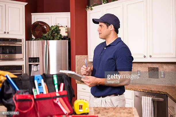 repairman working inside customer's home. - inspector stock pictures, royalty-free photos & images