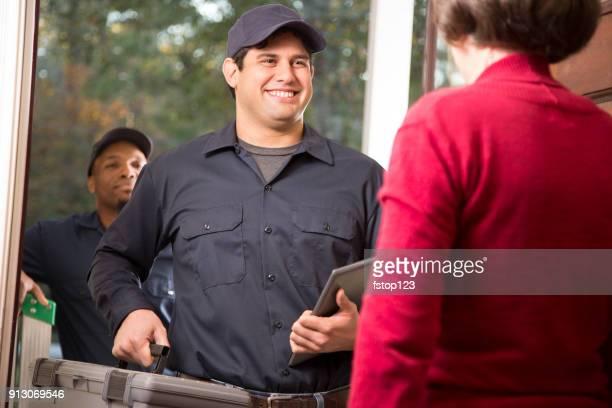 Repairmen arrive at customer's front door for home repairs.