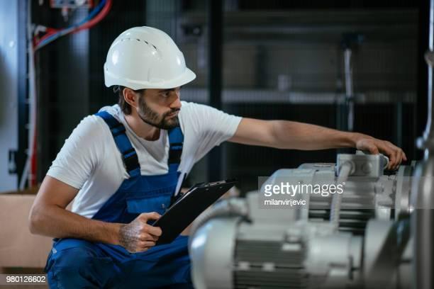 repairmen in boiler room checking pressure - water pump stock pictures, royalty-free photos & images