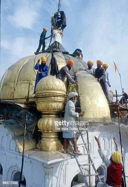 Repairs begin at the Golden Temple after the operation in 1984 in Amritsar, India.