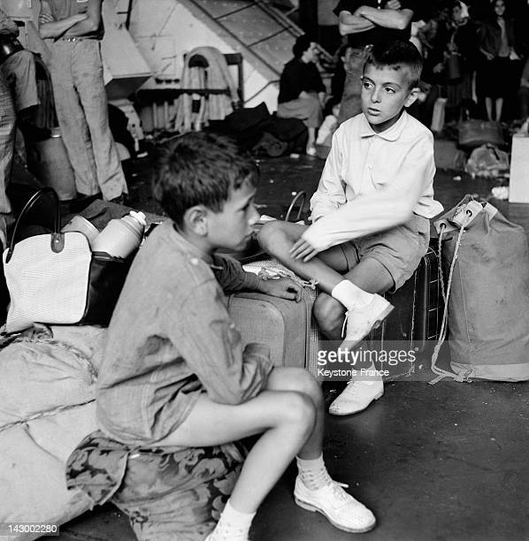 Repatriated people from Algeria arrive in Marseille aboard the ship Ville De Tunis in Marseille France on July 20 1962 Pictured two boys sitting on...