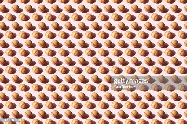 repeated baseball ball on the pink background - baseball sport stock pictures, royalty-free photos & images