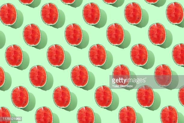 repeated watermelon on the green background - green colour ストックフォトと画像