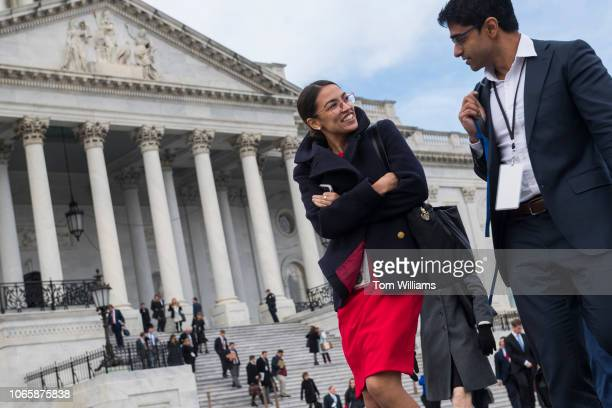 Repelect Alexandria OcasioCortez DNY arrives for the freshman class photo on the East Front of the Capitol on November 13 2018