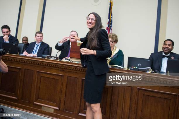 Repelect Alexandria OcasioCortez DNY reacts after drawing number 40 during the new member room lottery for office space in Rayburn Building on...