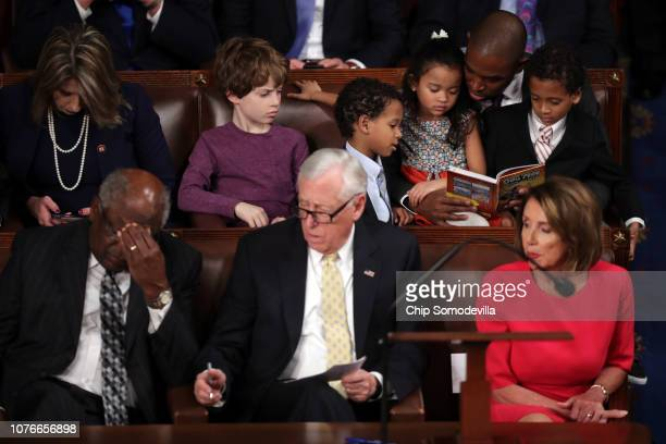 Repelect Antonio Delgado reads to children as House Assistant Democratic Leader Rep James Clyburn House Minority Whip Steny Hoyer and...