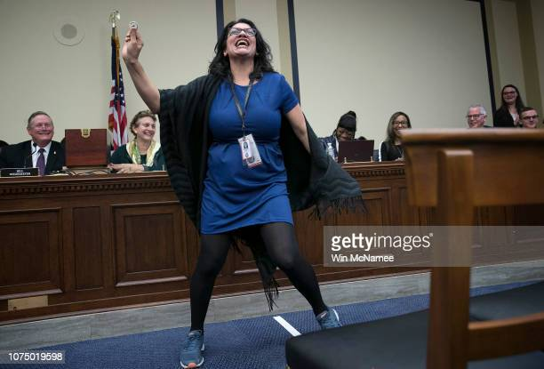 Rep.-elect Rashida Tlaib celebrates after drawing the number 8 in the lottery draw for congressional offices November 30, 2018 in Washington, DC. As...