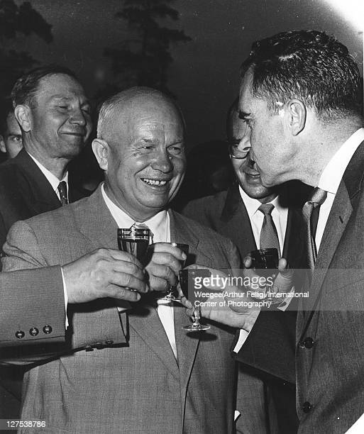 Rephotographed image of Russian politician and Soviet Premier Nikita Khrushchev as he smiles and shares a toast with American politician US Vice...