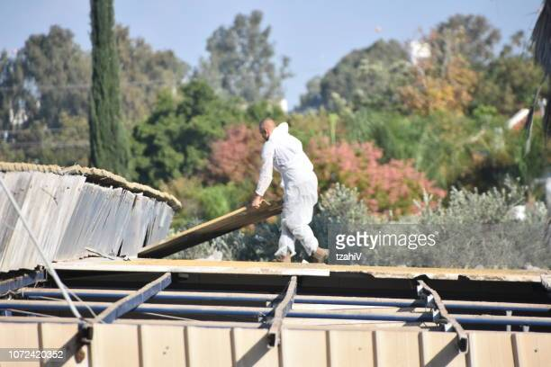 replacement of asbestos roof - asbestos stock pictures, royalty-free photos & images