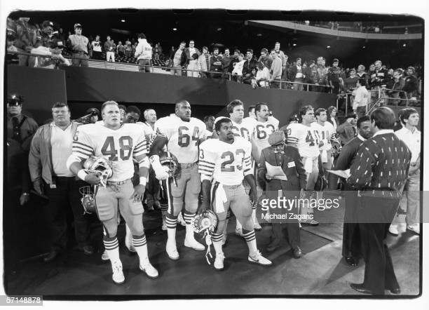 Replacement players Mike Varajon Michael Durrette and Tony Cherry of the San Francisco 49ers wait to enter the field before the game against the New...