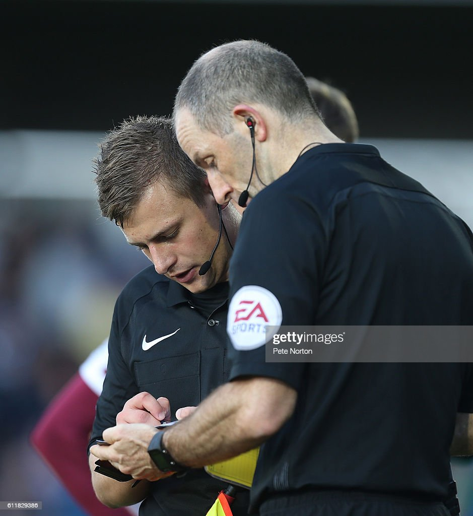 Replacement referee Josh Smith takes notes from Referee Graham Horwood who had to leave the pitch with an injury during the Sky Bet League One match between Northampton Town and Bristol Rovers at Sixfields Stadium on October 1, 2016 in Northampton, England.