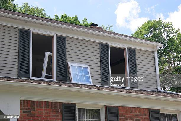 replacement windows being installed in house - installing stock pictures, royalty-free photos & images