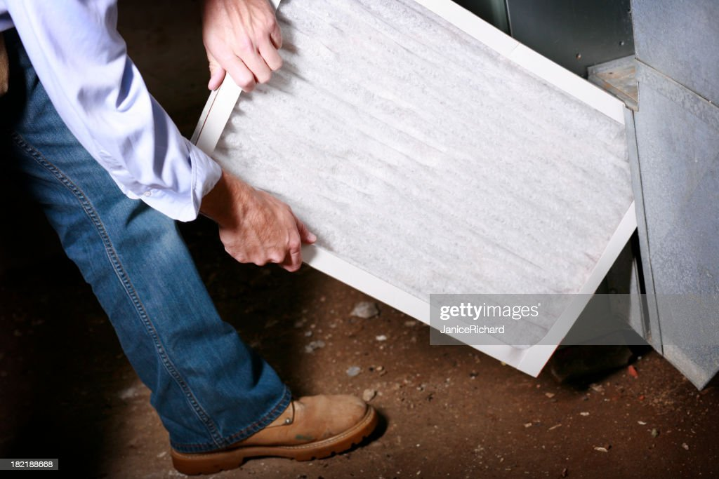 Replacing Air Filter in a Furnace : Stock Photo