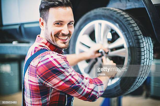 Replacing car wheel and tyre.