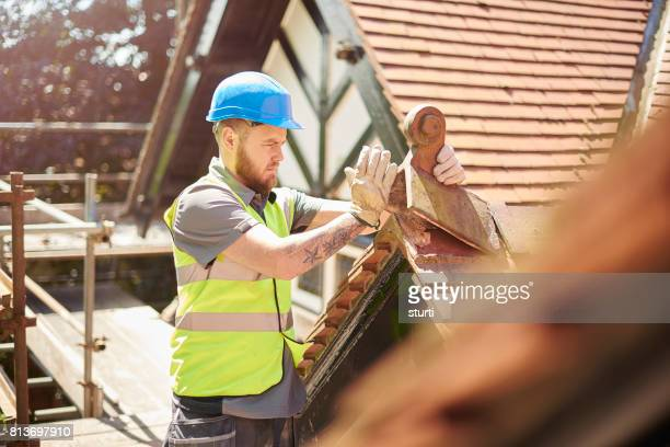 replacing old tiles - roof stock pictures, royalty-free photos & images
